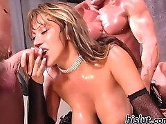 Busty vixen rides two massive meat poles