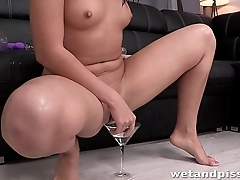 This young slut just loves to piss