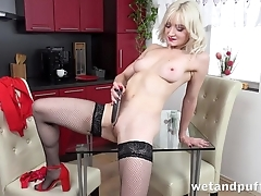 XXX blonde round stockings pleases herself with dildo