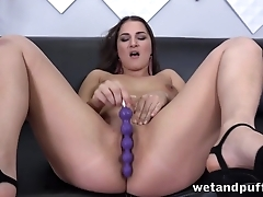 Dazzling MILF fatherland mating toys into pussy during solo