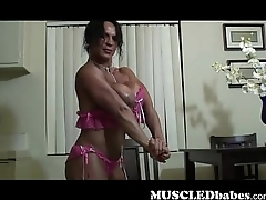 Muscled Babe Strips And Teases